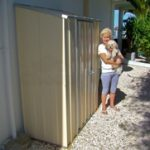 YardSaver slim line storage shed placed right against the wall