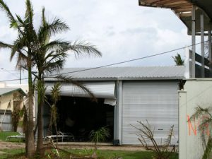 Failure of overhead roller door - 2006 Cyclone Larry. (Source: AIR)