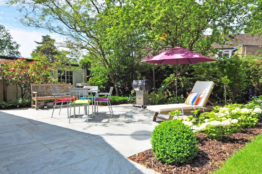 make your backyard look great - install pavers